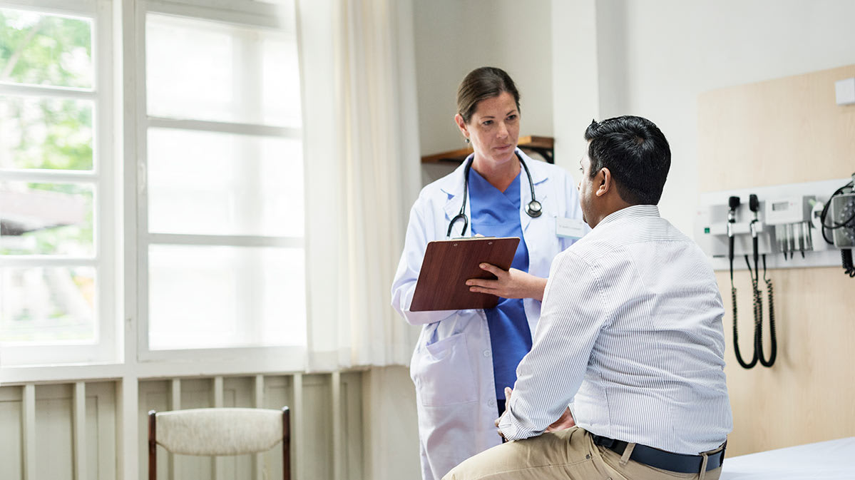 A doctor talking to a male patient.
