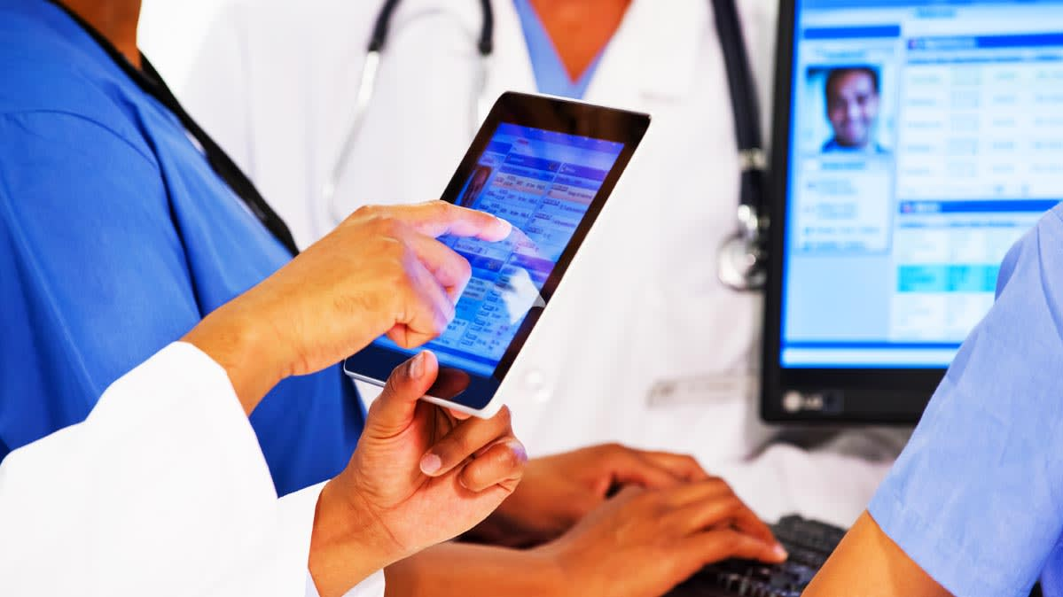 Health practitioners using a tablet and a computer. There are steps you can take to keep your health information private.