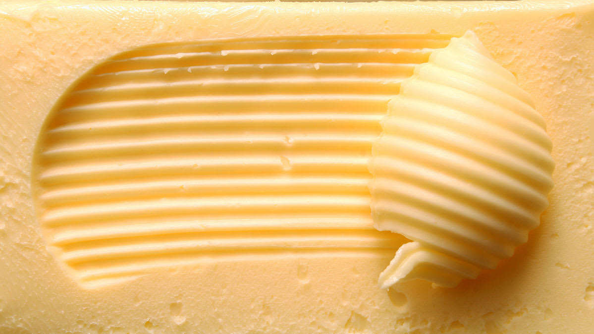 A scoop of butter. Butter is a source of saturated fat.