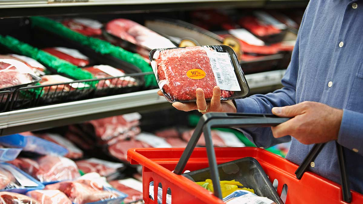 A shopper considering ground beef.