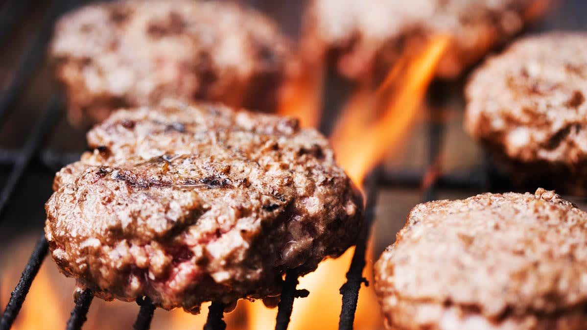 Following 17 illnesses and one death, Cargill issued a large ground beef recall. Pictured: beef patties cooking.