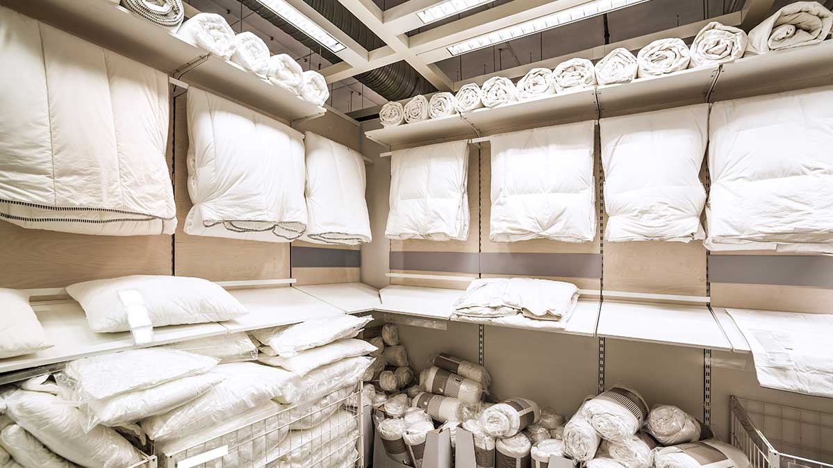 An aisle of bedding for a pillow shopping trip.