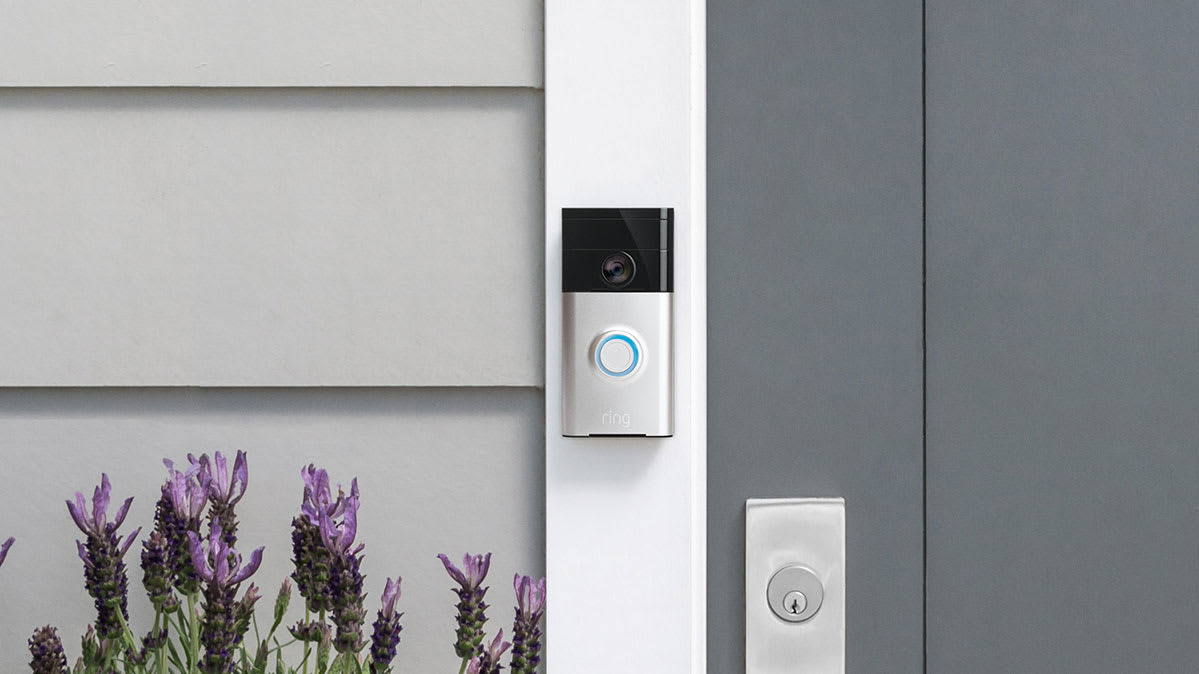 A video doorbell next to a door.
