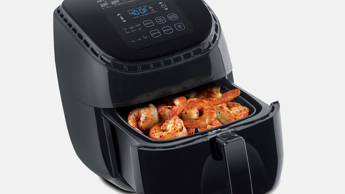 An air fryer cooking a shrimp dish