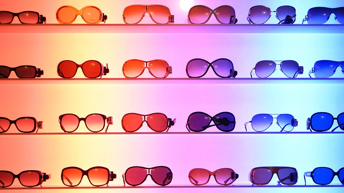 Several shelves full of sunglasses