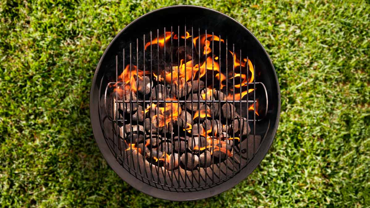 Flames rising from a charcoal grill.