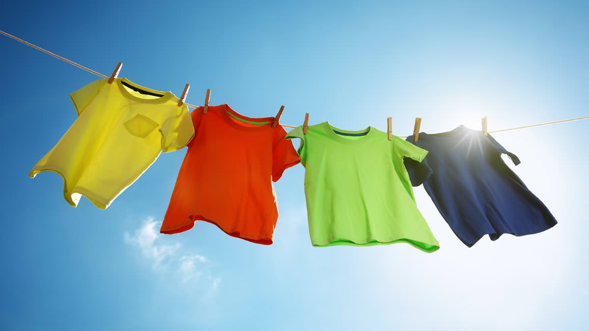 Colorful shirts on a clothesline.