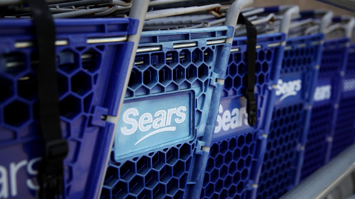 Rows of blue Sears shopping carts.
