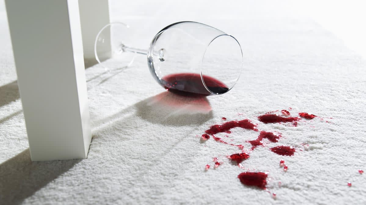 Photo of a red wine stain removal on carpeting