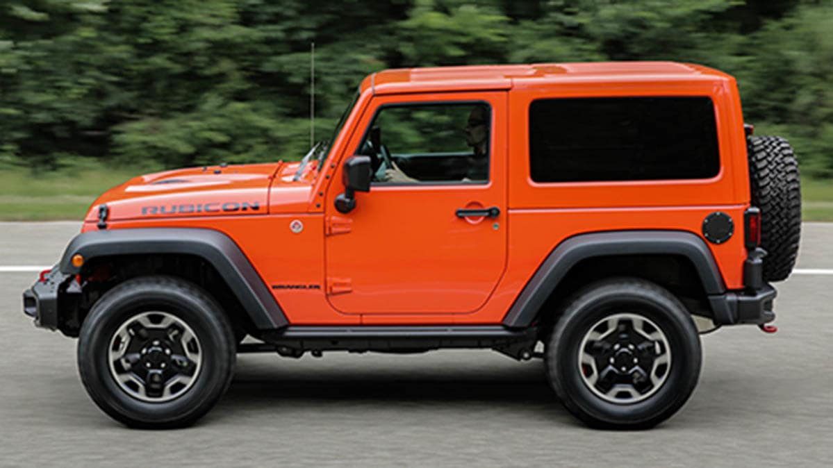 an orange jeep wrangler, one of the vehicles that Jeep may recall