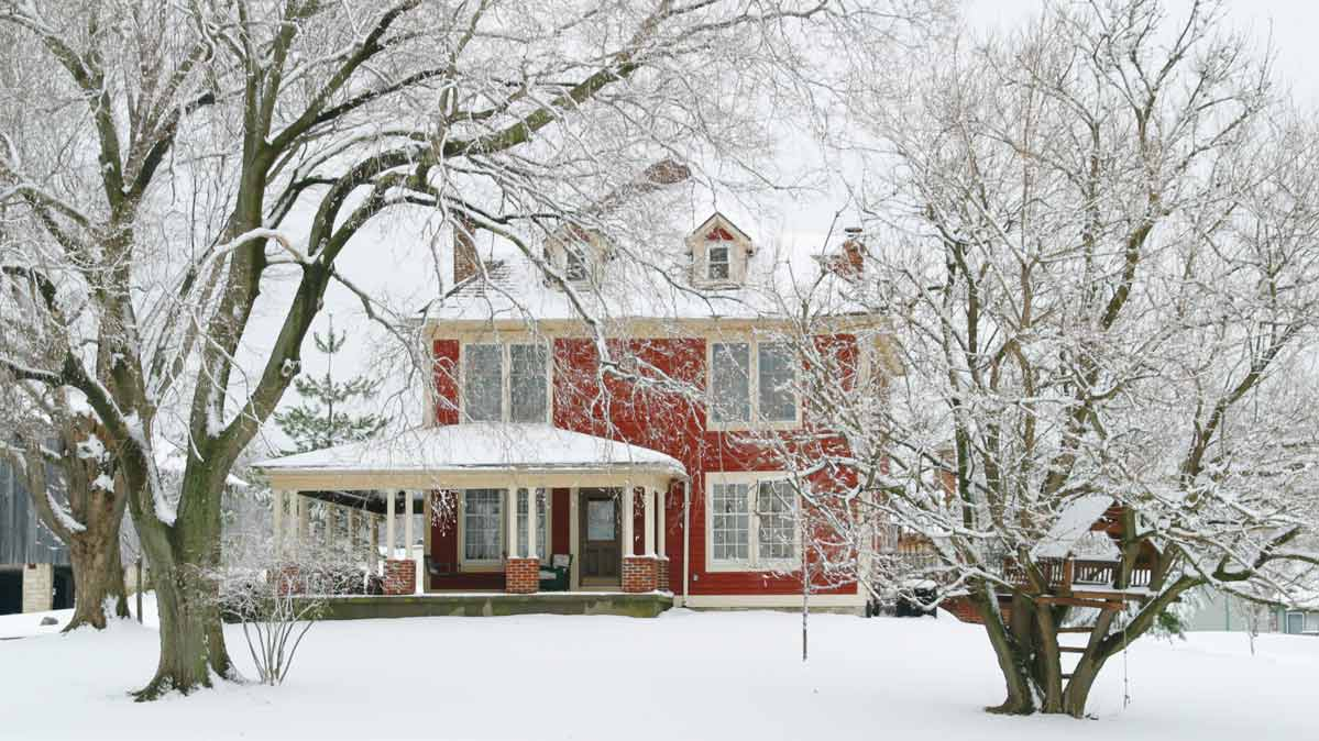 A red house in the snow.