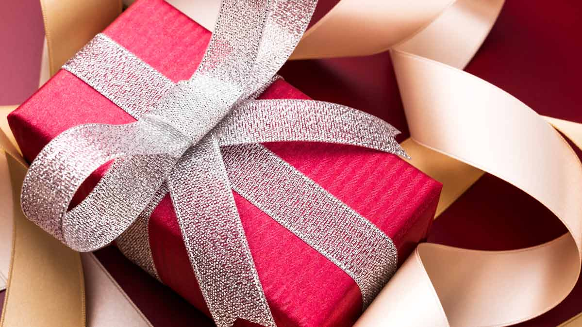A holiday gift wrapped in a bow.