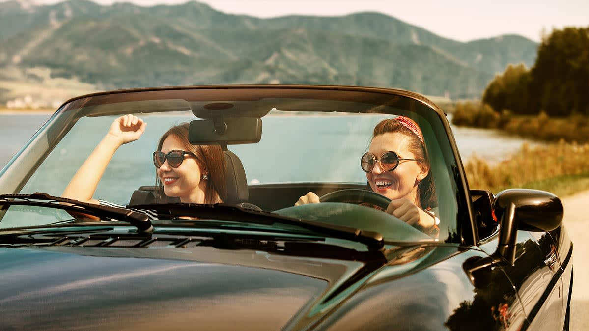 Two women in a convertible.