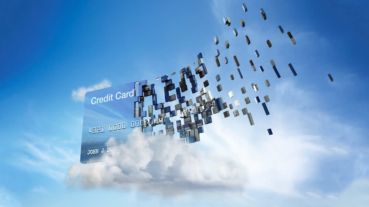 A credit card disintegrating in the sky.