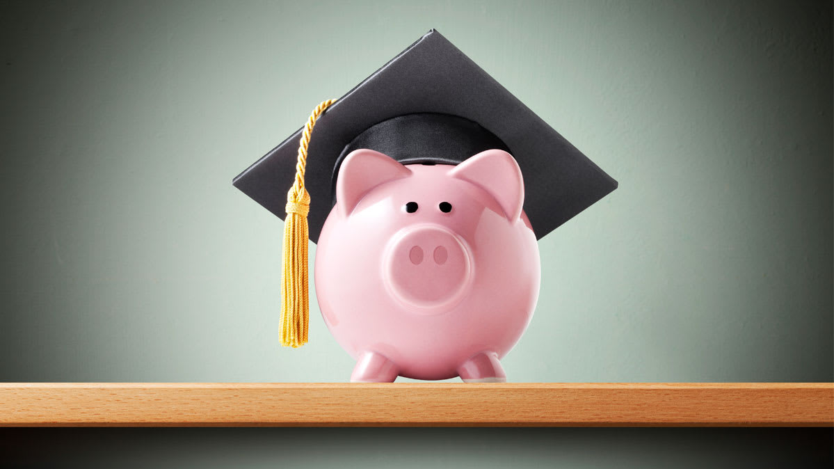 A piggy bank wearing a mortarboard.