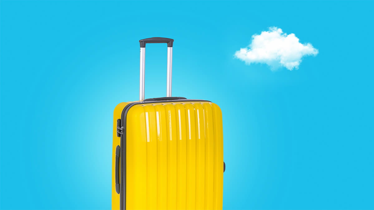 A yellow hard-sided suitcase