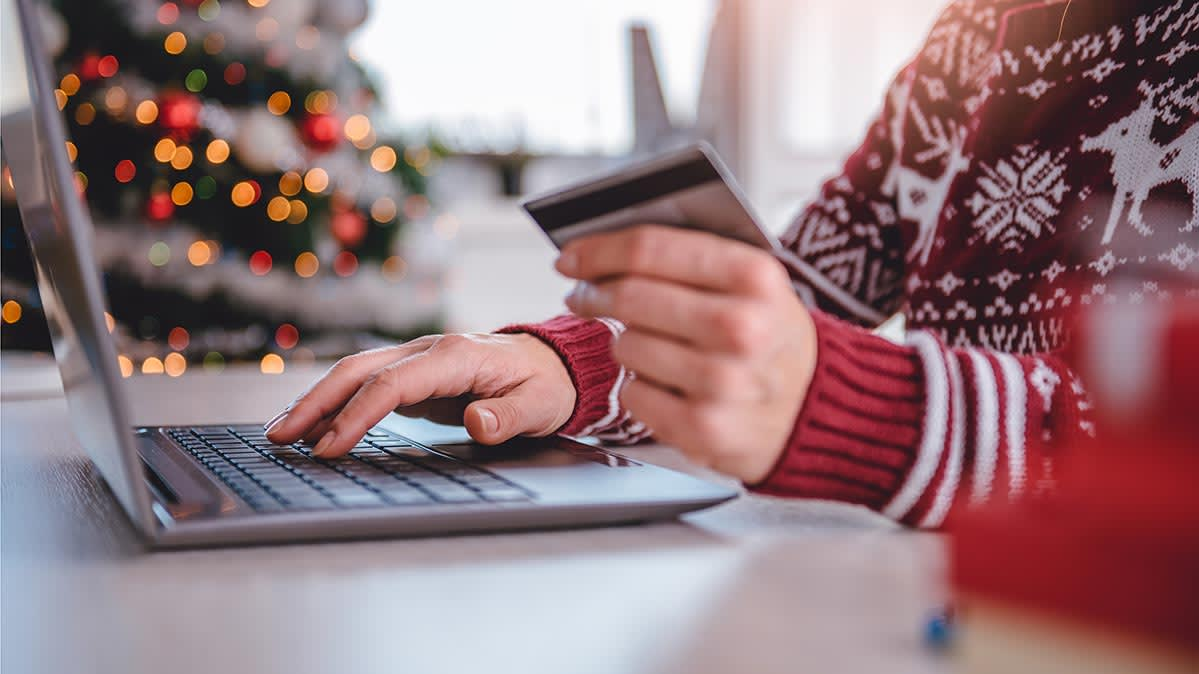 A person using a credit card to make an online purchase