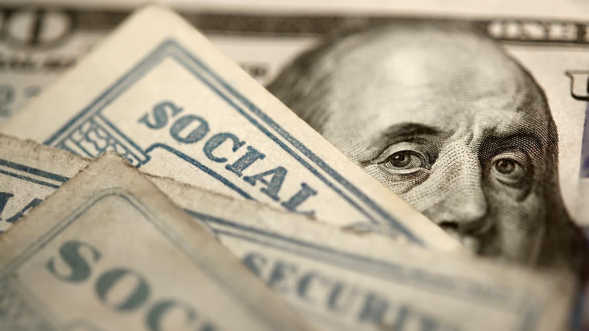 Social Security cards on top of a $100 bill