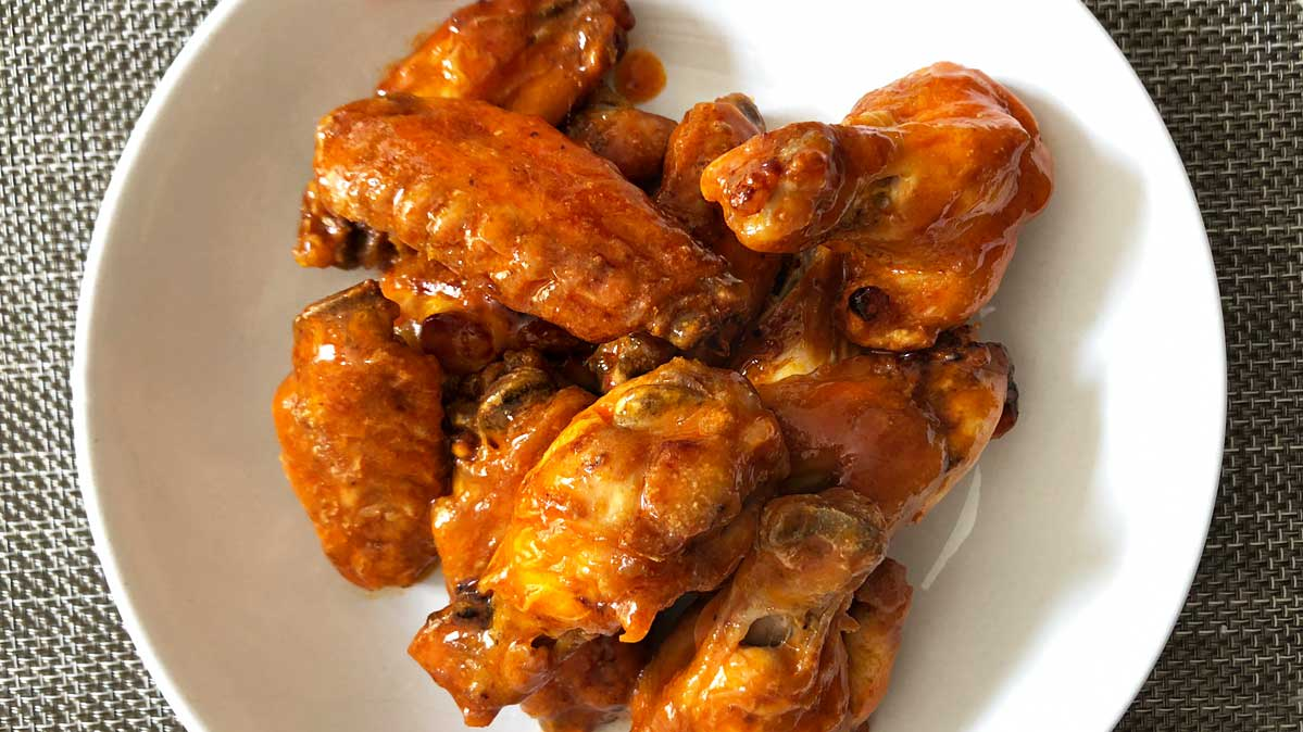 A plate of Buffalo chicken wings.