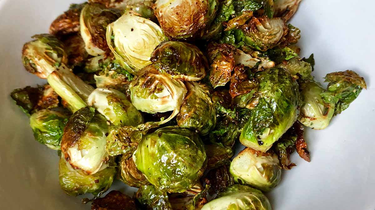 Brussels sprouts that have been cooked in an air fryer are nicely browned and crispy.