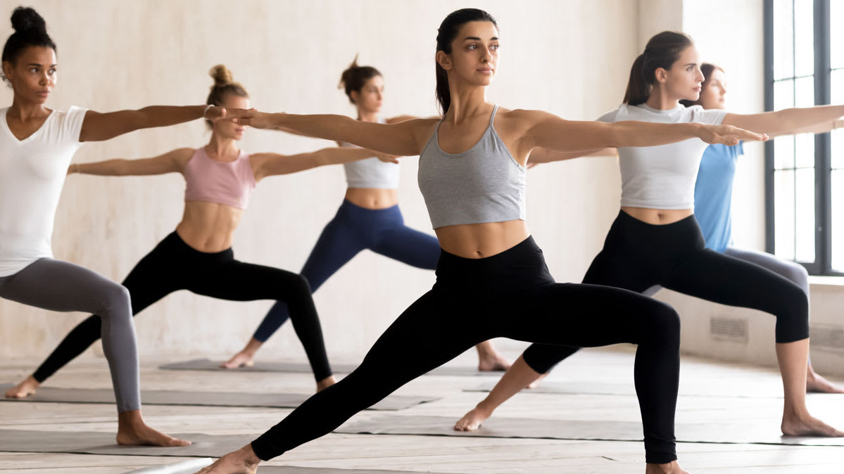 A group of women wearing Lululemon are doing yoga