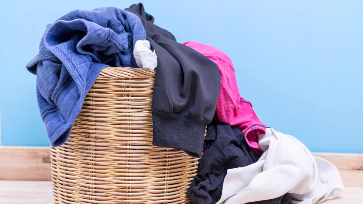 A basket of dirty laundry, and laundry tips from Consumer Reports.