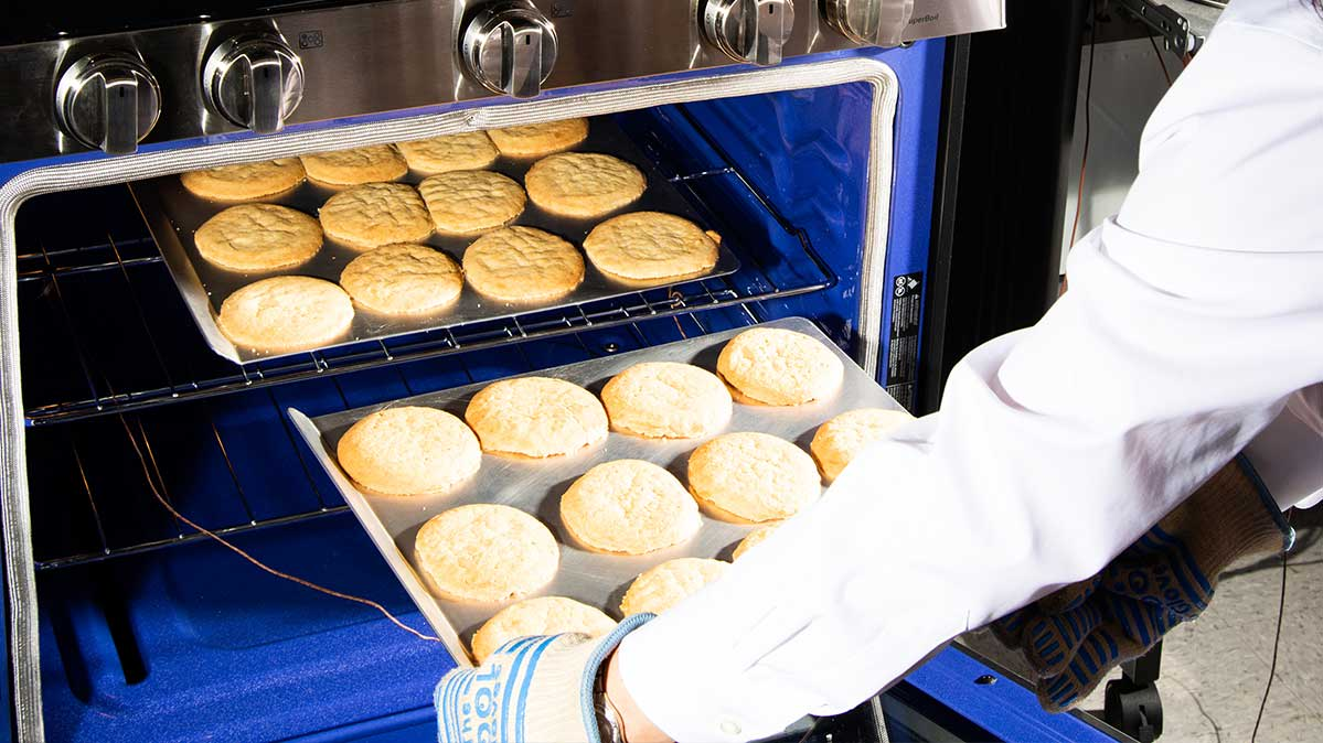 Cookies being baked during the testing of ranges by Consumer Reports
