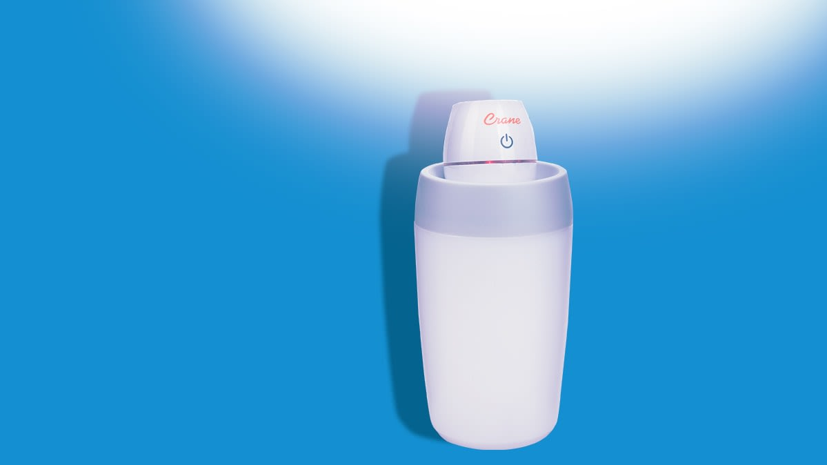 A personal-sized humidifier is emitting moisture into the air.