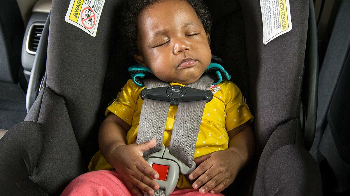 A baby sleeping in a car seat