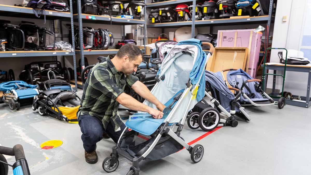 A CR tester is putting one of the best strollers through one of Consumer Reports' test procedures.