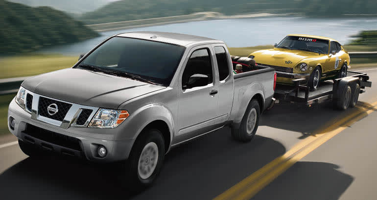 Nissan Frontier pickup truck towing a car