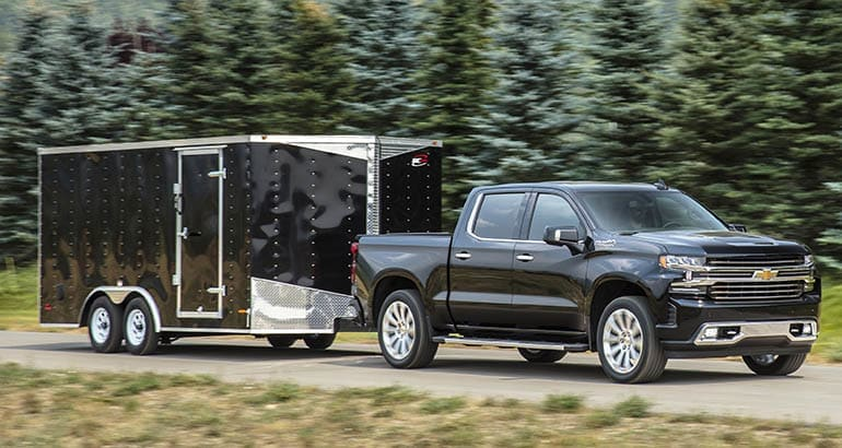 2019 Chevrolet Silverado towing a black trailer