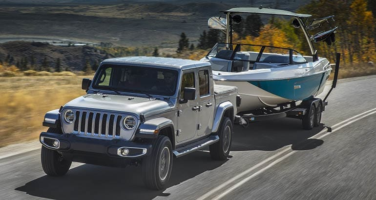 Jeep Gladiator pickup truck towing a boat