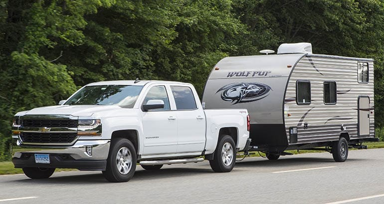 Chevrolet Silverado 1500 towing a travel trailer