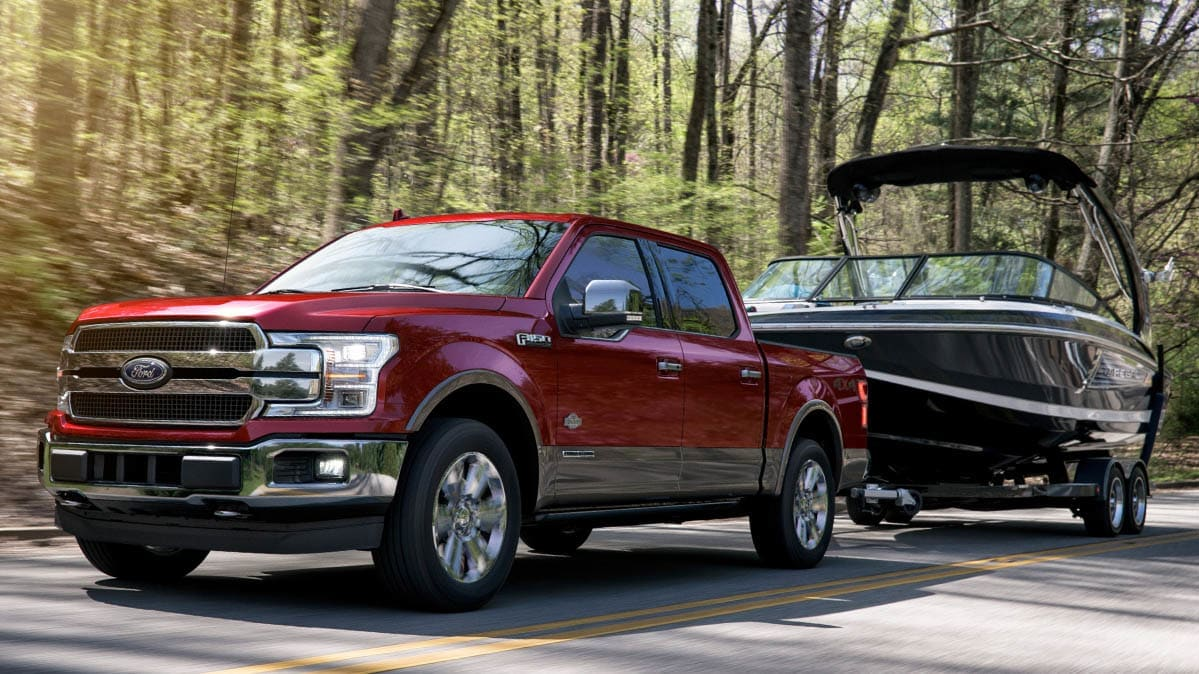 Ford F-150 pickup truck towing a boat