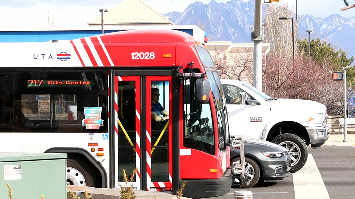 A red-and-white metro bus on the streets of Salt Lake City
