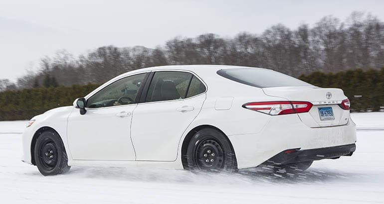 Testing all-season tires in the snow on a Toyota Camry.