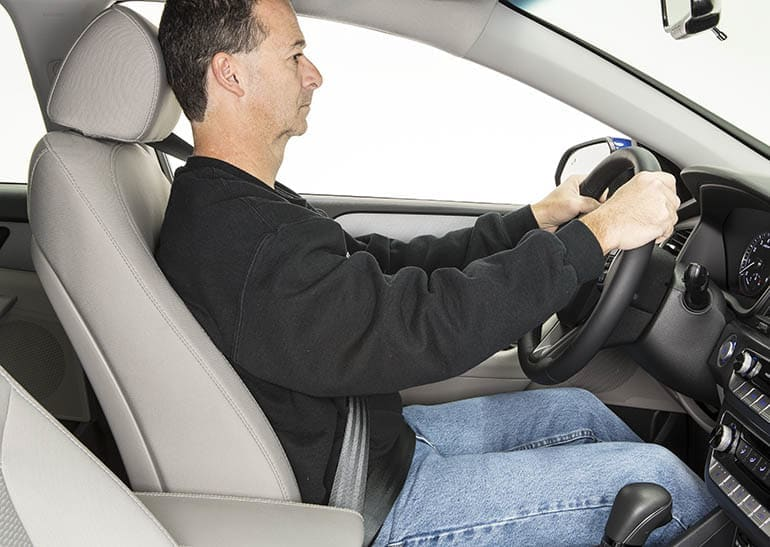 Driver shown evaluating the best car, SUV, and truck front seats.
