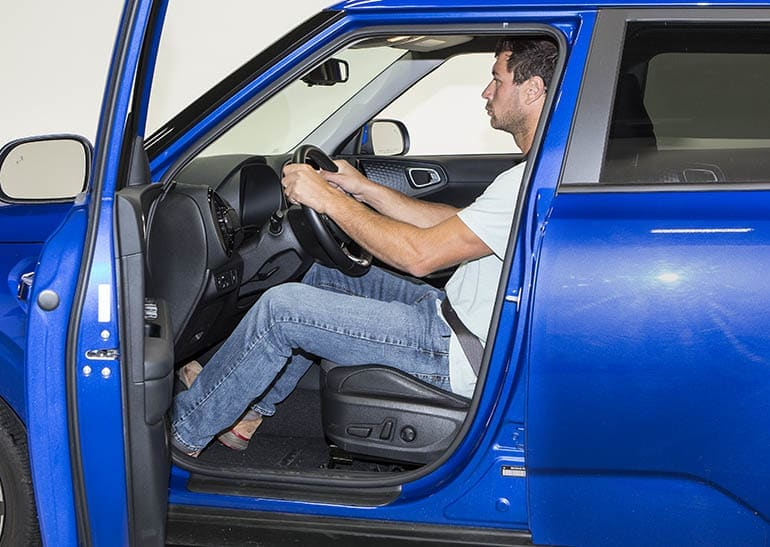 Best Cars for Tall People, tall driver shown fitting in a compact car