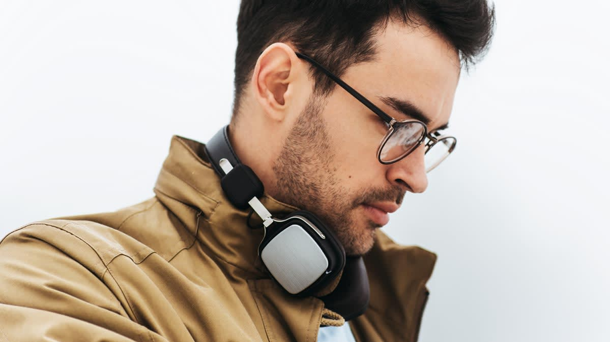 A person wearing a pair of wireless headphones.