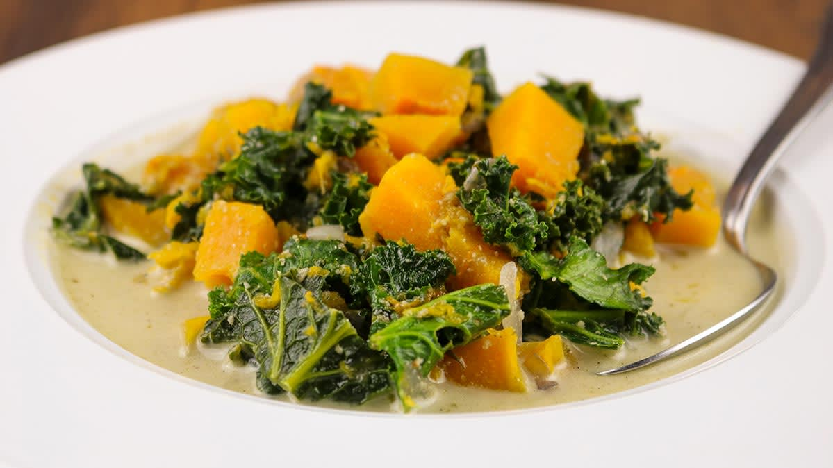 Butternut squash and kale soup is a healthy slow cooker meal.
