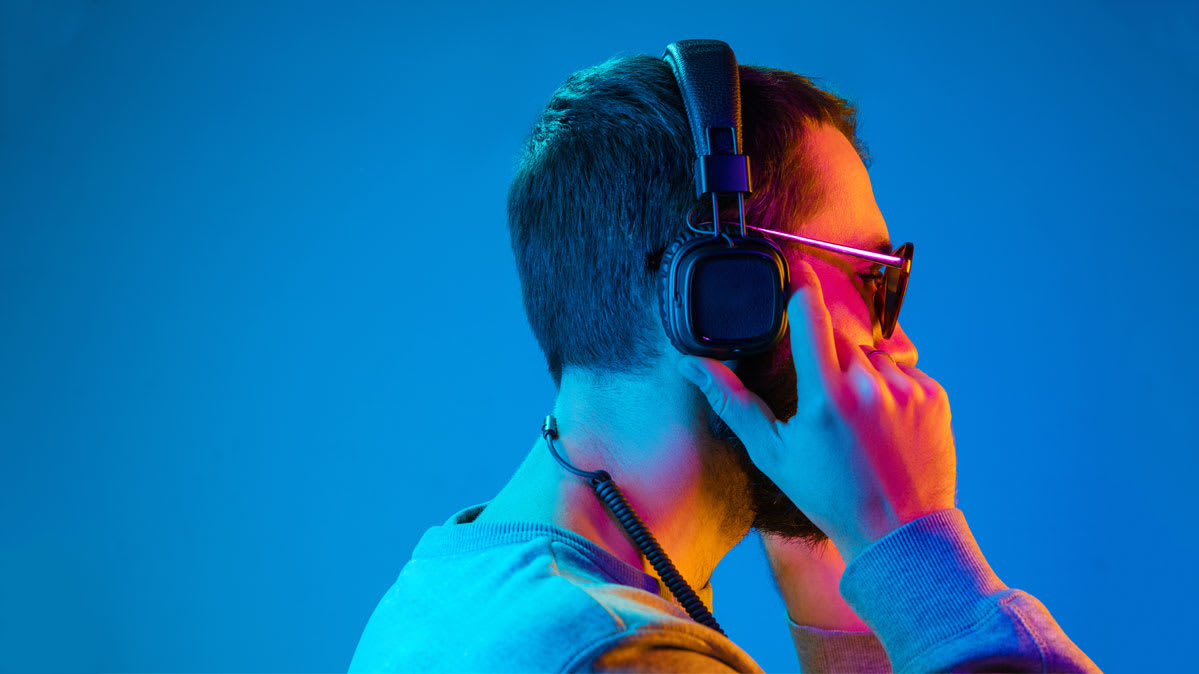 Photo of a man wearing a pair of budget headphones