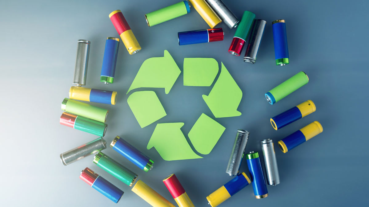 The recycle symbol surrounded by batteries.