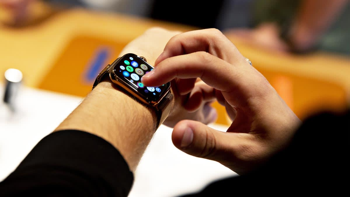 A person tapping on an Apple Watch display
