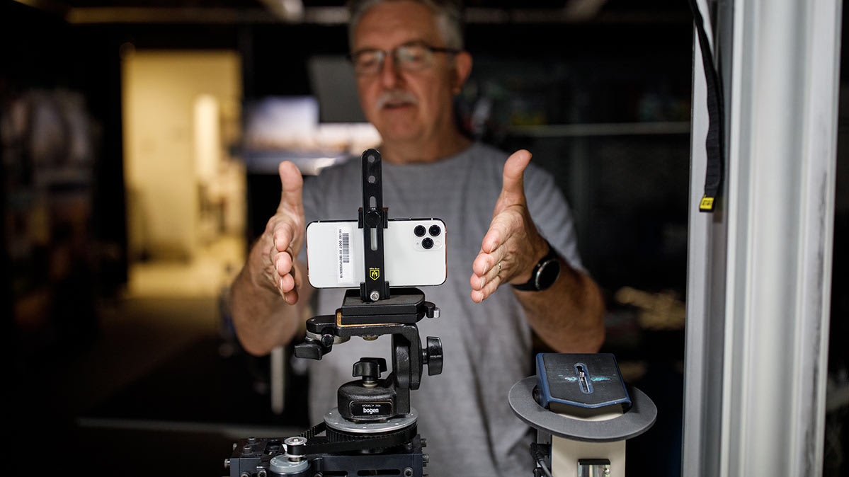 A Consumer Reports tester sets up an iPhone to examine the new camera features.