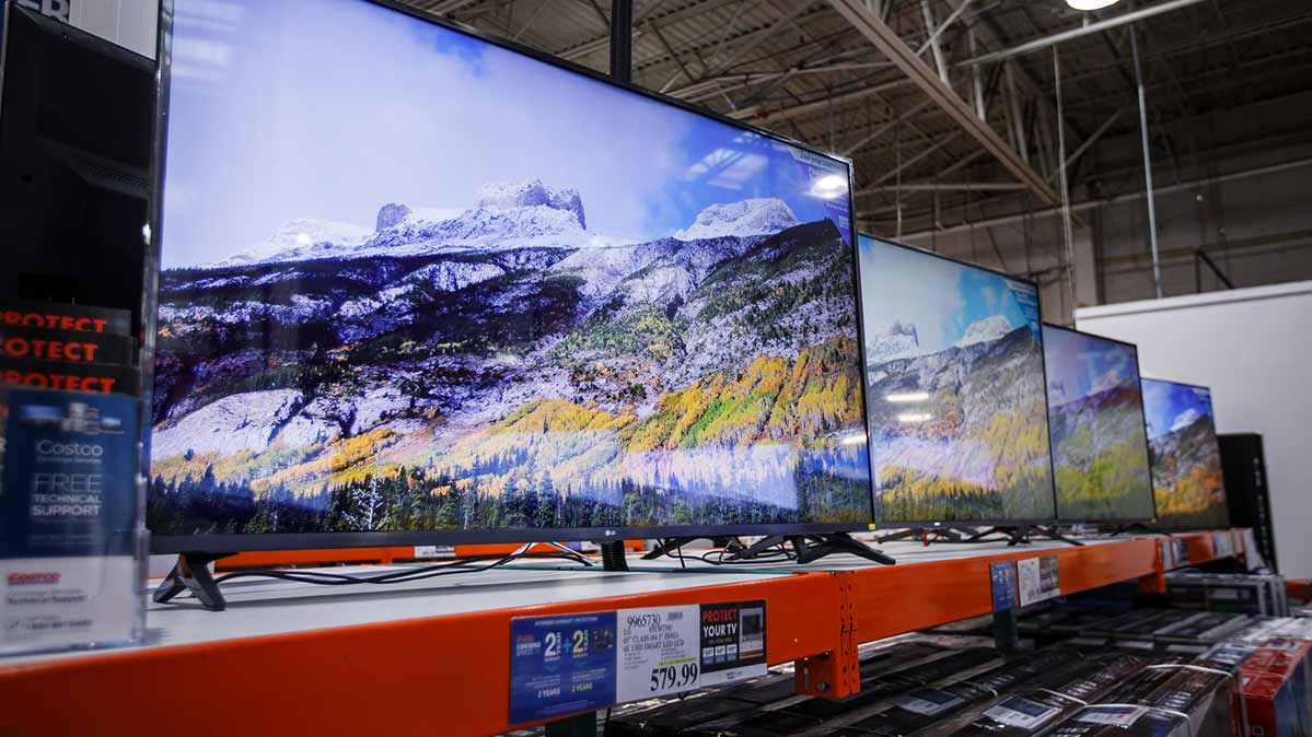 Several TVs on display at a store
