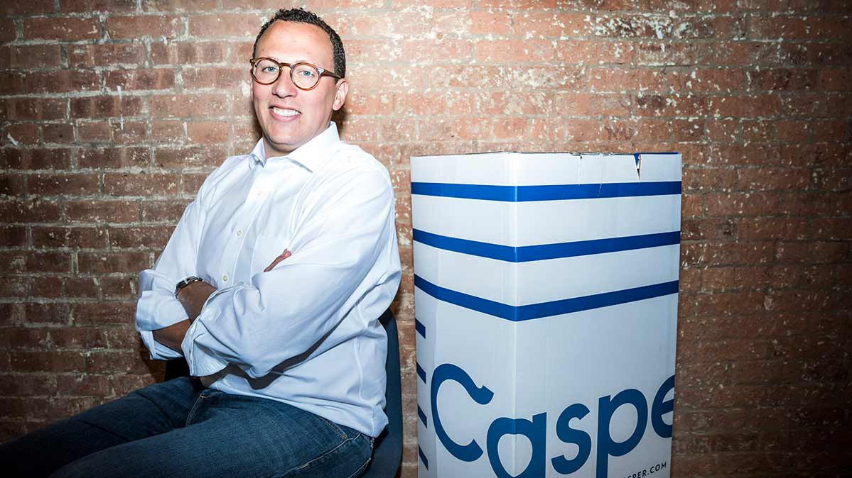 Philip Krim, CEO of Casper, with a Casper mattress box