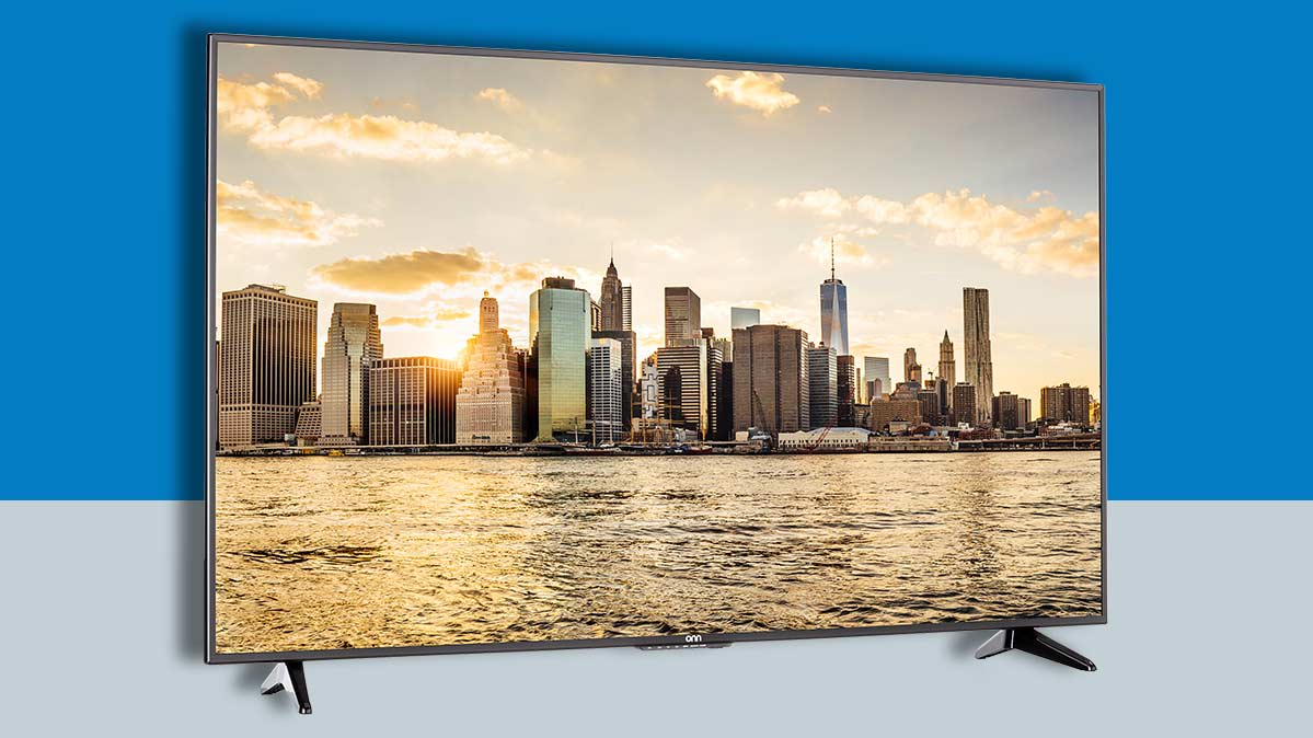 Large flat-screen TV on display featuring a prominent image of a city skyline.