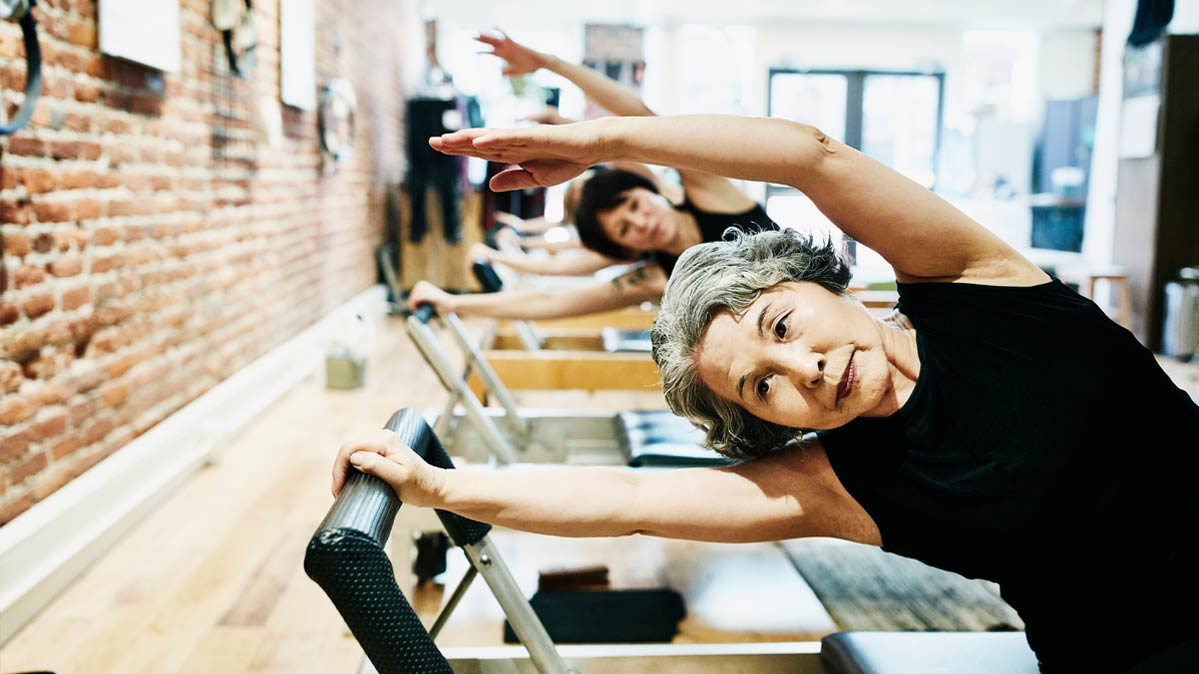 Two women doing stretching exercise