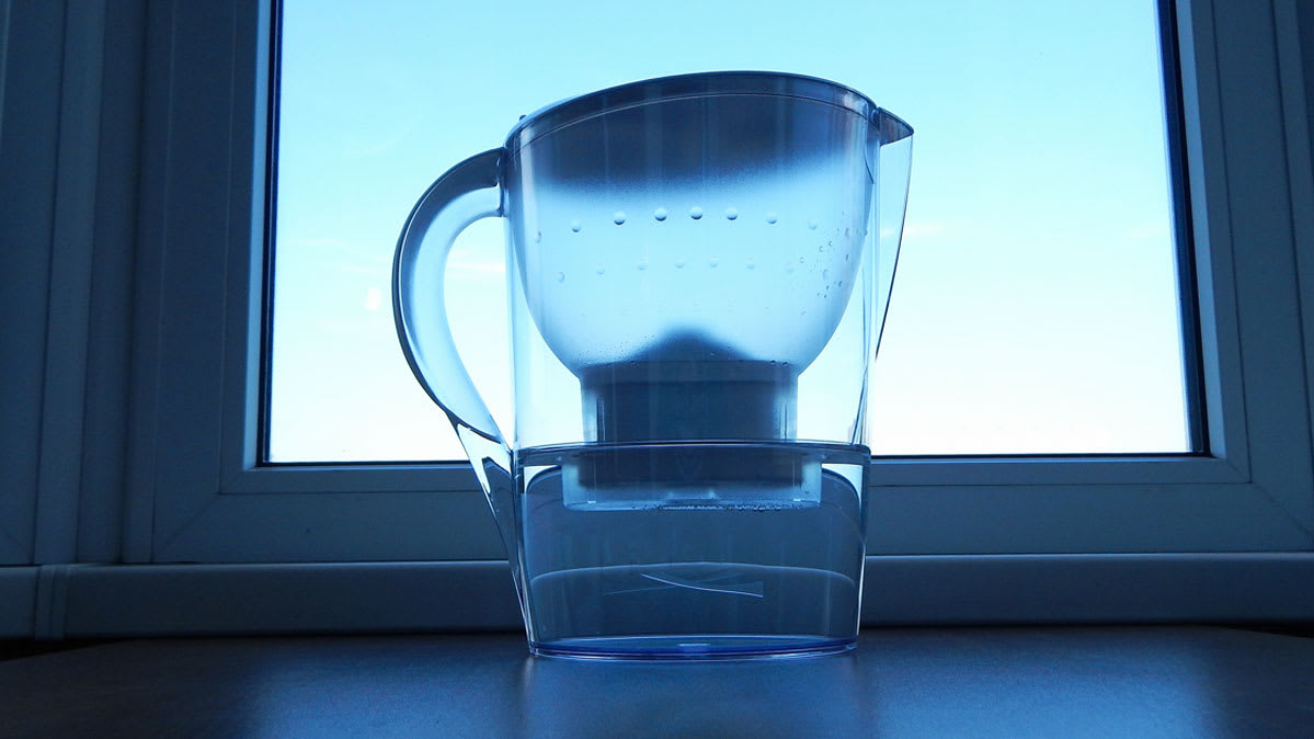 A water filter pitcher on a kitchen countertop